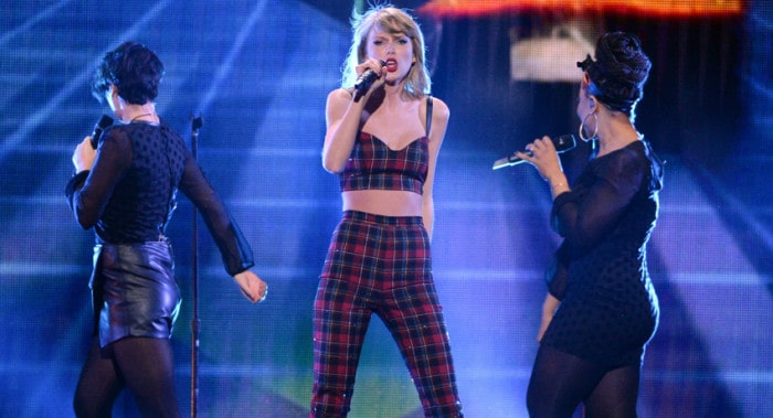 Taylor Swift performs at Z100 Jingle Ball at Madison Square Garden, Friday, Dec. 12, 2014, in New York. (Photo by Evan Agostini/Invision/AP)