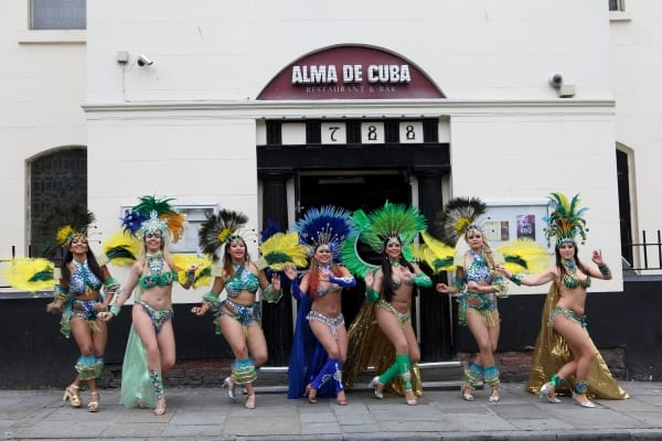 Seven dancers outside Alma de Cuba - credit David Munn - Low Res